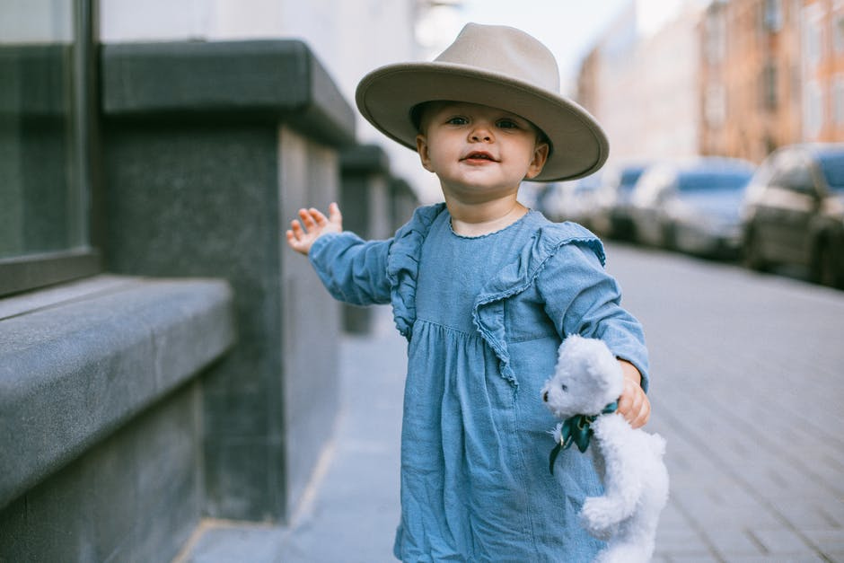A little boy wearing a hat