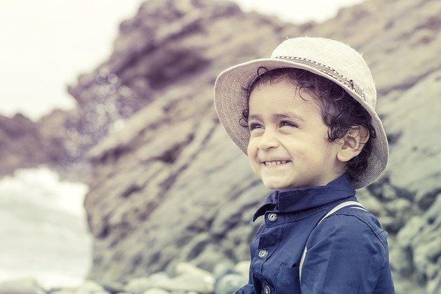 A young boy wearing a hat